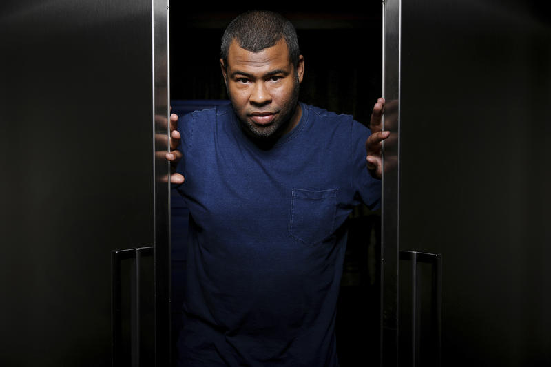"In this Feb. 9, 2017 photo, Jordan Peele poses for a portrait at the SLS Hotel in Los Angeles to promote his film, ""Get Out."" Peele's thriller sensation crossed $100 million over the weekend, reaching that milestone in just 16 days."
