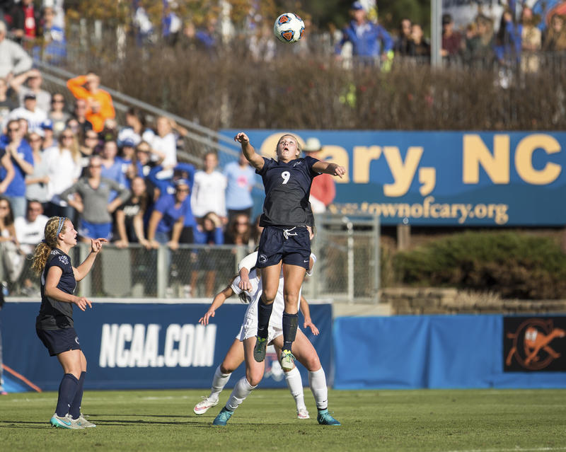 FILE - In this Dec. 6, 2015, file photo, Penn State's Frannie Crouse (9) jumps for a header as teammate Emily Ogle, left, watches during the NCAA Women's College Cup soccer final against Duke in Cary, N.C.