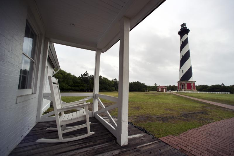 The Cape Hatteras Lighthouse seen from the light keepers house in Buxton. The lighthouse was put in service in 1870 and is the world's tallest brick lighthouse at 208 feet. Its beacon can be seen 20 miles out at sea.