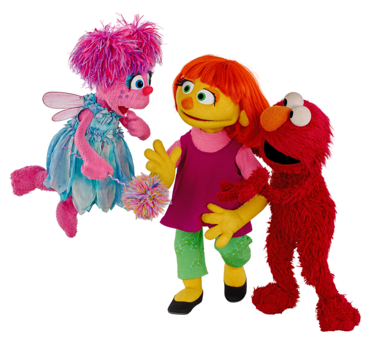 "The puppet in the middle of the photo, ""Julia"", is a new 'Sesame Street' character designed to teach children about autism."