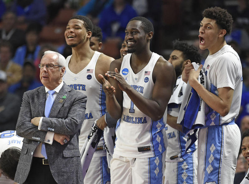 In this March 17, 2017, file photo, North Carolina head coach Roy Williams, left, and players Kennedy Meeks, Theo Pinson and Justin Jackson react during the second half against Texas Southern in a first-round game of the NCAA men's college basketball.