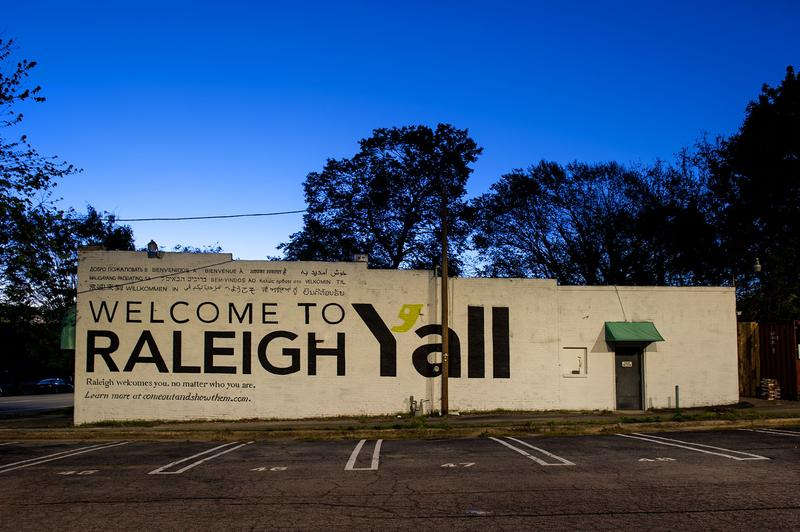 The Welcome to Raleigh Y'All mural is hand-painted.