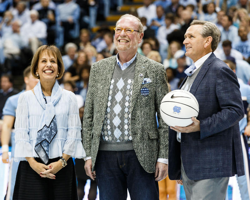 Alexander Julian (center) was honored at the Dean Dome in March 2017 for the 25th anniversary of UNC's men's basketball's recognizable argyle patterned uniforms.