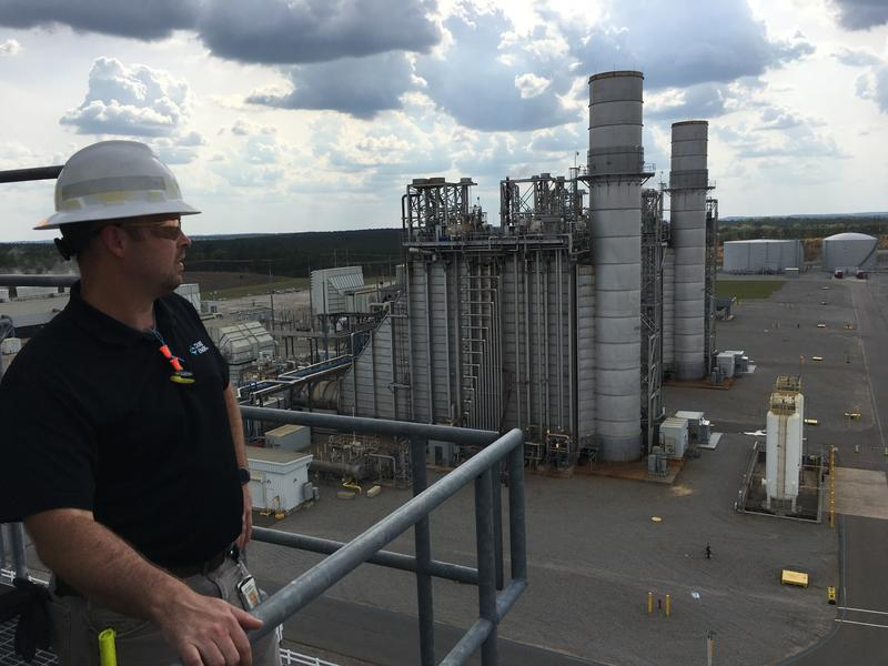 Plant manager Tom Hanes looks out over the Duke Energy natural gas-fired plant in Hamlet.