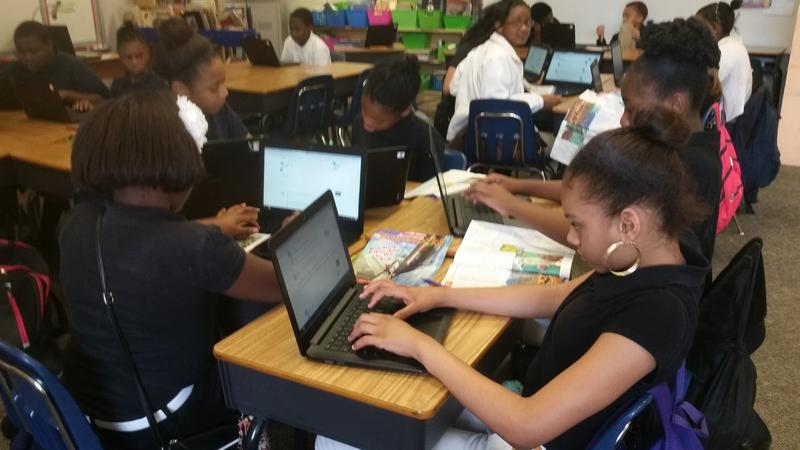 Fifth-graders at Mariam Boyd Elementary in Warrenton, North Carolina, use Chromebooks to answer questions about a story they're reading. Their teacher, Charis Shattuck, says the technology allows her to review her students' work in real-time and give them