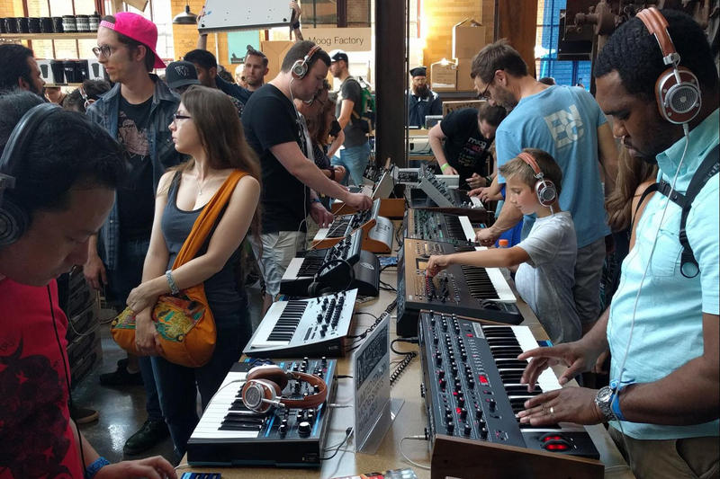 Keyboardist Jonathan Lim (front left) of Washington, D.C. and music producer Brandon Collins of Raleigh explore the sounds of the synth keyboard.