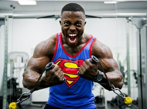 A beefy weightlifter wearing a Superman tank top appears to roar as he flexes his arm muscles during a rep.