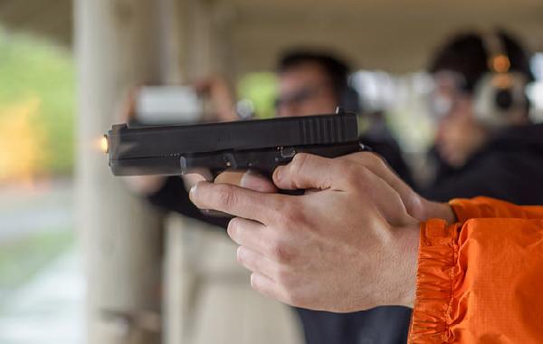 Man holding hand gun