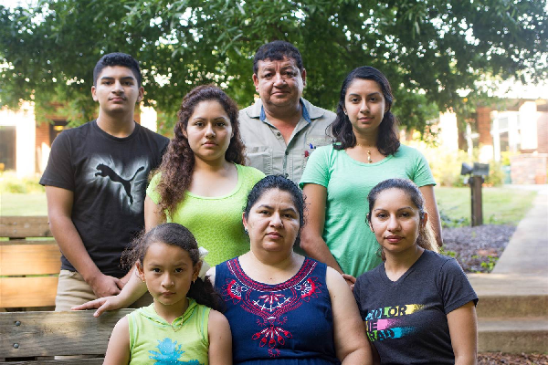 Juana Tobar Ortega with her family outside St. Barnabas Episcopal Church in Greensboro, North Carolina. Standing, left to right: Carlitos Ortega, Yeimy Tobar, Carlos Ortega (husband) and Jackie Tobar. Seated, left to right: Koral Briguette (granddaughter)