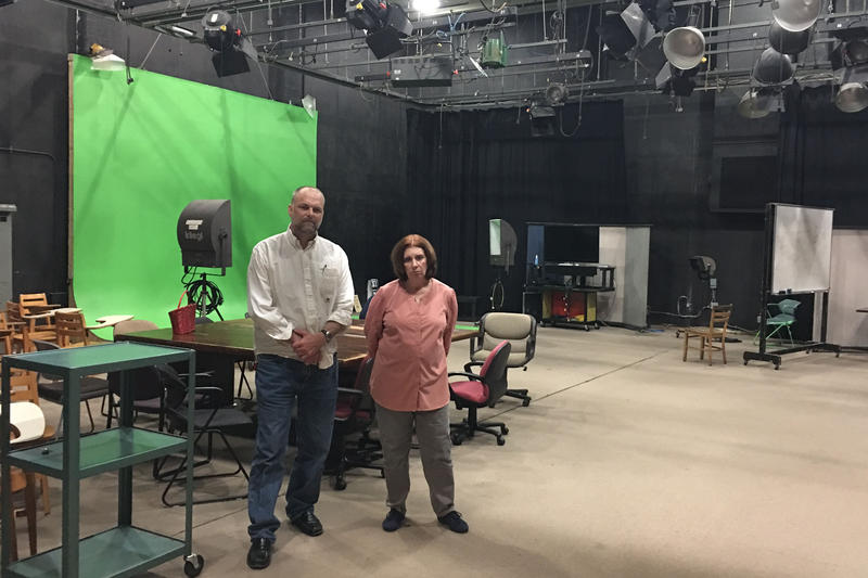 UNC-Chapel Hill professors Mark Robinson and Cori Dauber stand in an empty studio in Swain Hall. They had hoped to use a federal grant to fill the space with students developing multimedia to fight extremist groups.