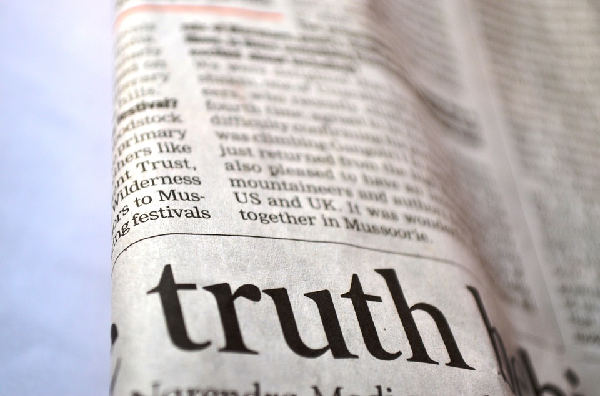 Newspaper, image enhanced to highlight word, 'truth'