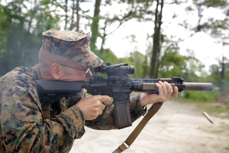 Christian Wade of the 2nd Marine Division at Camp Lejeune shoots a suppressed carbine. The surpressor is the canister on the end of the barrel.