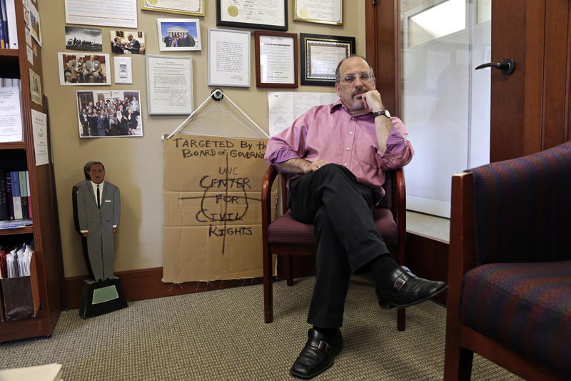 In this photo taken Thursday, April 20, 2017 Mark Dorosin, managing attorney at the UNC Center For Civil Rights poses for a photo in his office in Chapel Hill, N.C. The center founded at the University of North Carolina by a fearless civil rights attorney