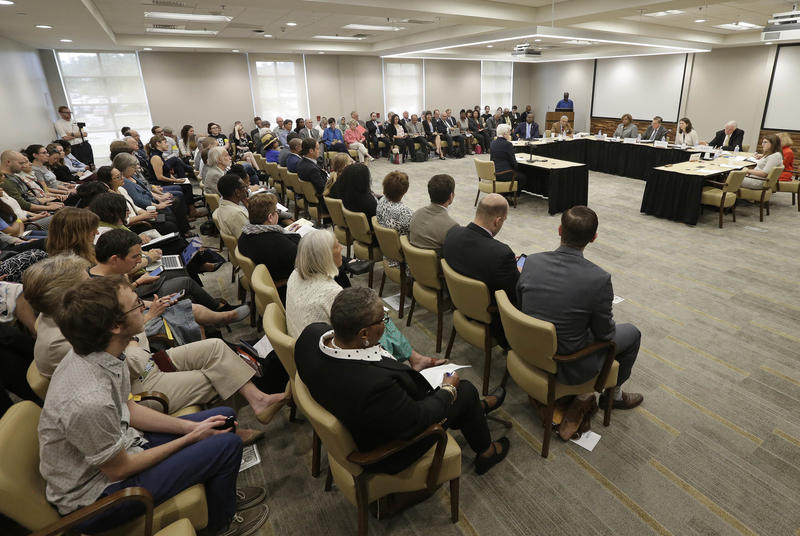In this photo taken May 11, 2017, a crowded room of concerned citizens listen during a public forum in Chapel Hill, N.C., regarding the UNC Center for Civil Rights ability to represent poor and minority clients in court.