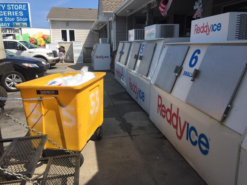 Ice is displayed at the Variety Store on Thursday, July 27, 2017, on Ocracoke Island on North Carolina's Outer Banks. An estimated 10,000 tourists were ordered Thursday to evacuate the island after a construction company caused a power outage