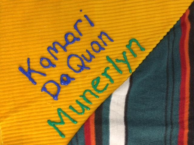 One of the most recent names added to the quilt was that of Kamari Munerlyn, a 7 year-old boy who was killed by gunfire in June 2017.