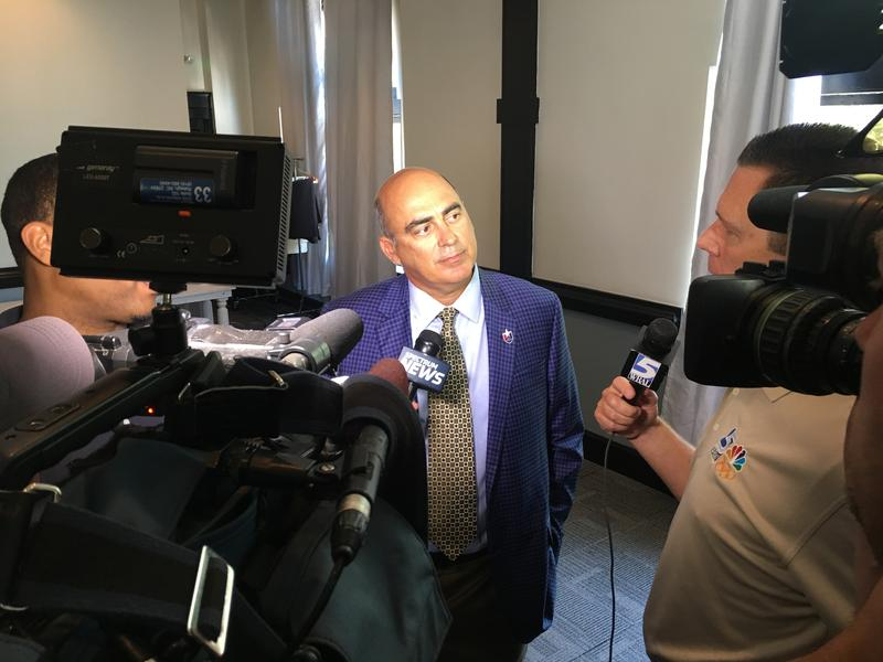 Steve Malik talks with reporters