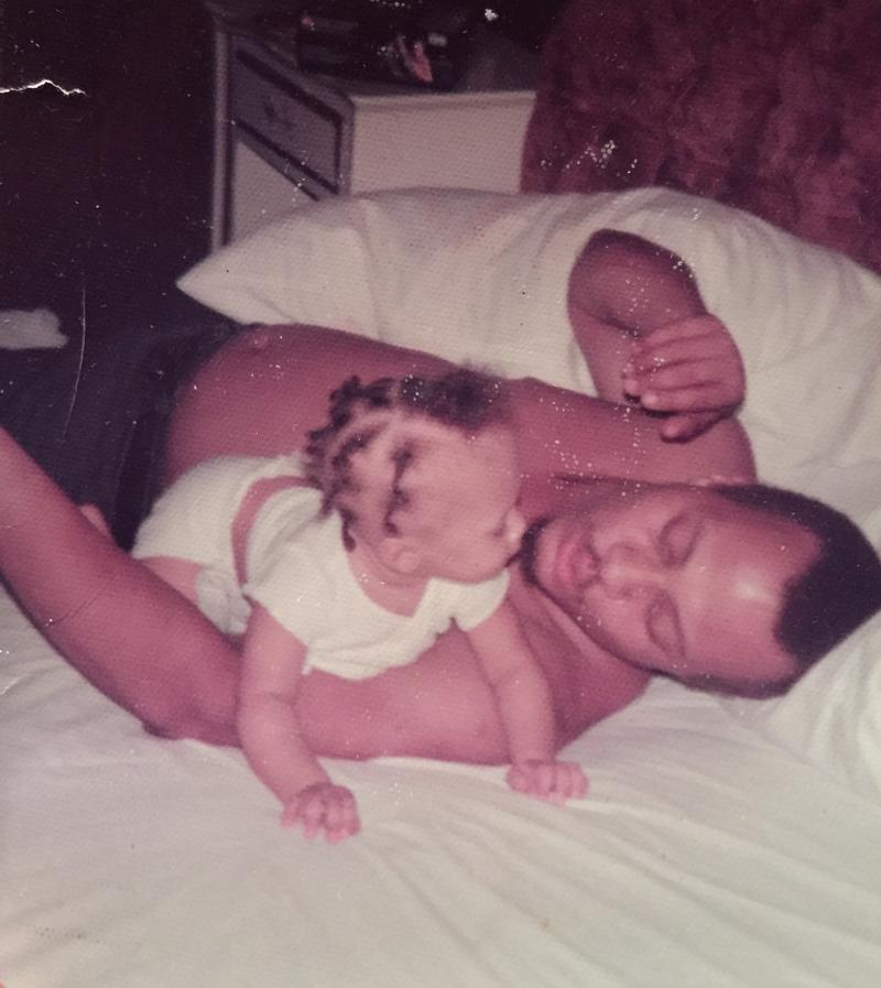Slack as a baby with his dad in 1974 on a bed