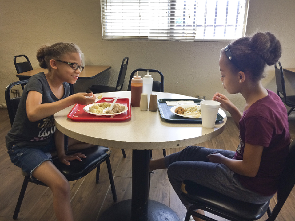 Tre's two daughters, Leah, 8, and Jade, 9, are the third generation of Tapps at Chicken Hut. They say they will take over the restaurant one day.