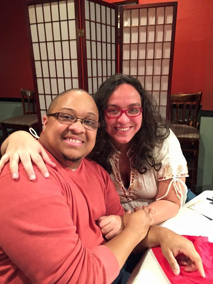 Mykal Slack pictured side by side in a restaurant with his wife LeLaina.