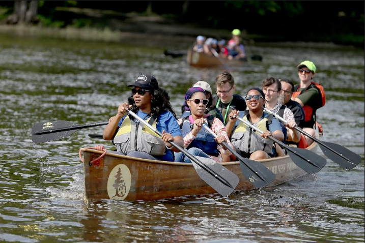 Rue Mapp, founder and CEO of Outdoor Afro, leads a paddle boat full of members.