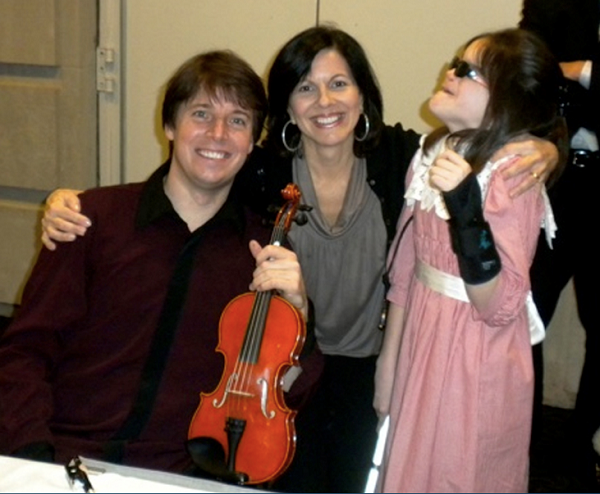 Mikels with violinist Joshua Bell.