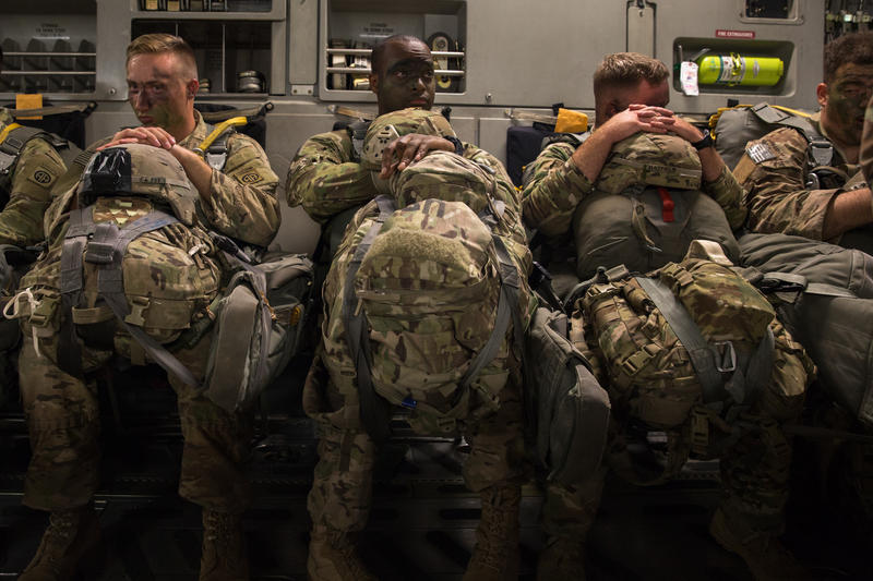 Specialist Christopher Byrum, Captain Marcus Fisher and Staff Sergeant Wesley Hatfield wait for the transport plane that they are on to be fixed before takeoff for a July training jump at Fort Bragg.