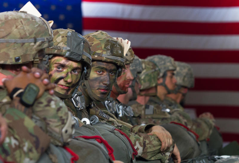 Paratroopers with the 82nd Airborne Division wait after being fitted with parachutes for an upcoming training jump at Fort Bragg, N.C. on July 26, 2017.