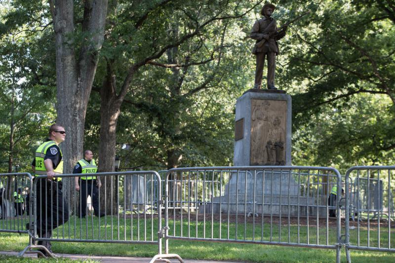 University police stand watch inside a barricade around the Silent Sam Statue at the University of North Carolina at Chapel Hill protestors for and against the statue's removal attended rallies near the statue on Tuesday, August 22, 2017.