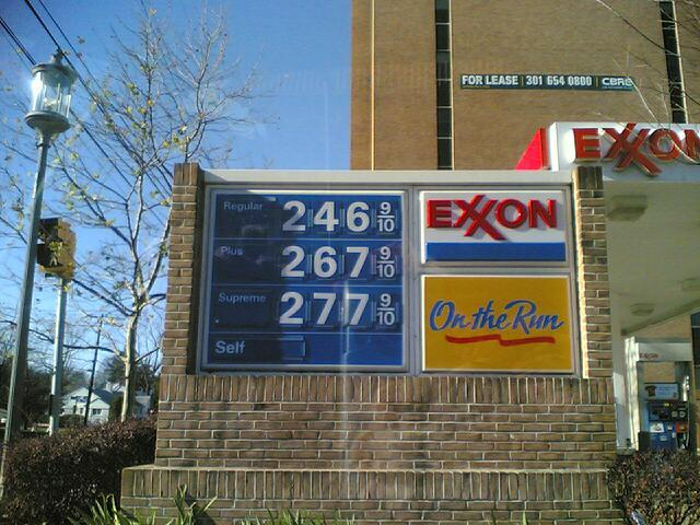 a sign showing gas prices