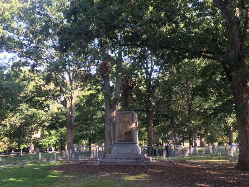 The 'Silent Sam' memorial on UNC's Chapel Hill campus is fenced off on Tuesday, August 22, 2017 in advance of a planned rally at the site.