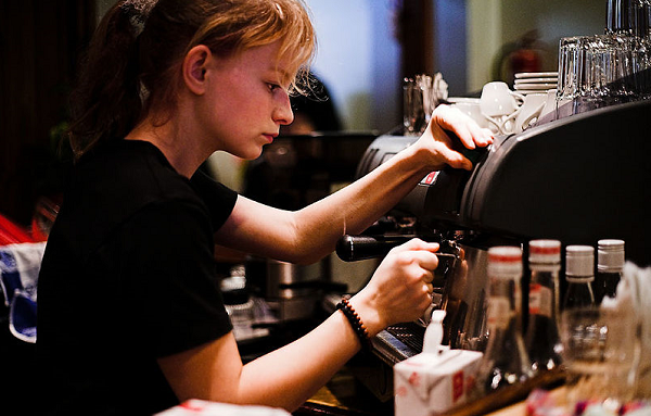 Female barista at espresso machine