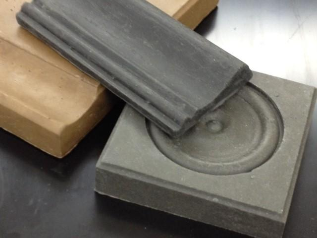 Sample products made using plastic and coal ash from ponds and landfills. Researchers at North Carolina A&T University have developed the composite building material and hope to eventually have it replace wood in some construction.