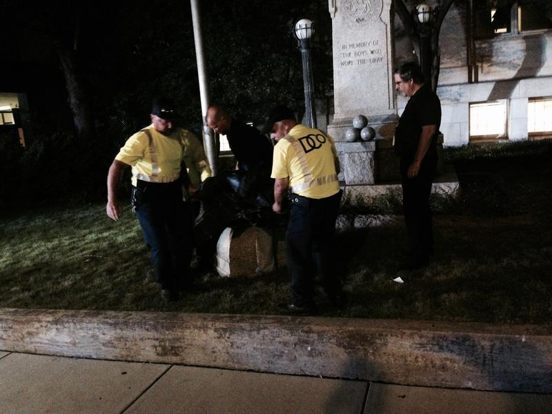 Durham County officials remove the Confederate statue that was pulled off its post by protestors.