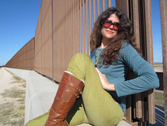 Stephanie Elizondo Griest at the U.S./Mexico border wall.