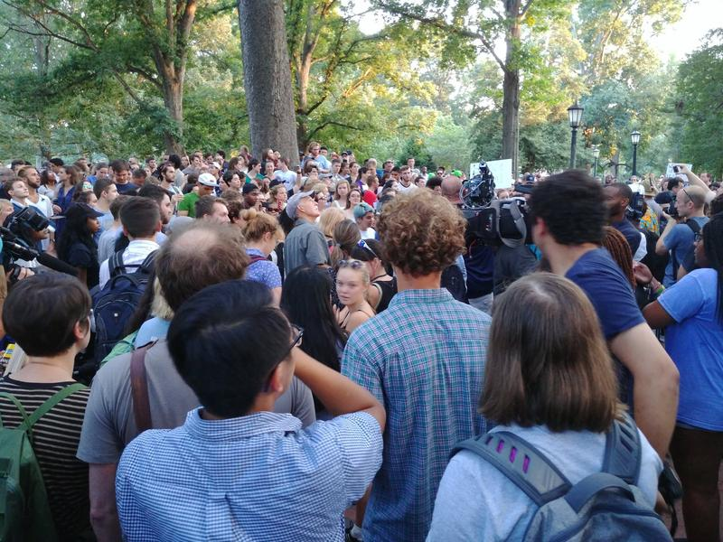 A crowd gathered at the 'Silent Sam' statue at UNC - Chapel Hill on Tuesday, August 22, 2017.