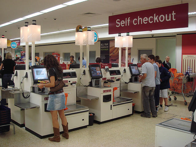 patrons at self checkout