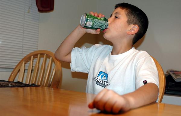 child drinks soda