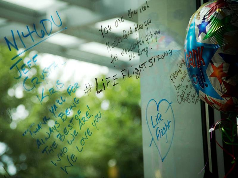 Duke community members leave messages on a memorial wall in Duke Medicine Pavilion.