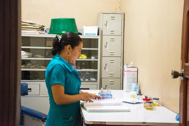 A nurse performs her work at a community health clinic.
