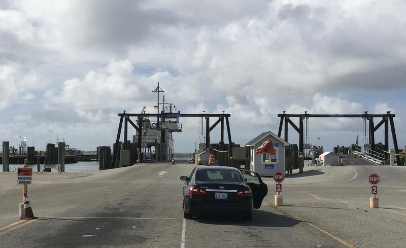 File photo of a lone car waiting to be loaded on a ferry to Ocracoke Island in Hatteras, N.C., Tuesday, Aug. 30, 2016. An evacuation is underway on Ocracoke Island on North Carolina's Outer Banks as Hurricane Maria moves north.