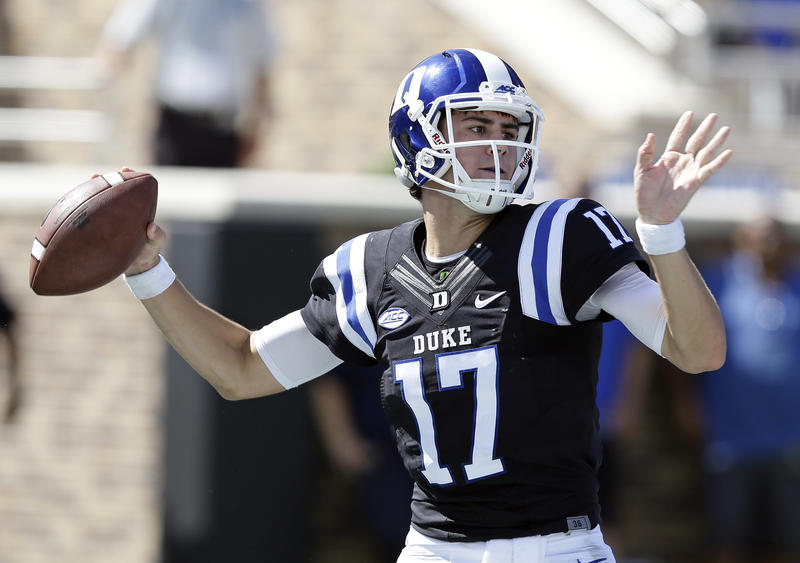 FILE - In this Oct. 1, 2016, file photo, Duke quarterback Daniel Jones (17) passes against Virginia during the first half of an NCAA college football game in Durham, N.C. The Blue Devils look to put a rough 2016 in the past when they begin a new season Sa