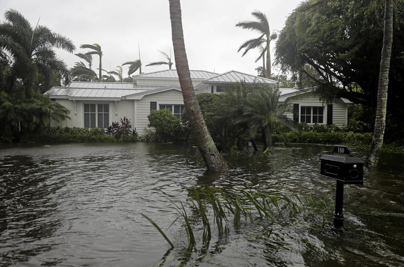 A houses is surrounded by water as Hurricane Irma passes through Naples, Fla., Sunday, Sept. 10, 2017.