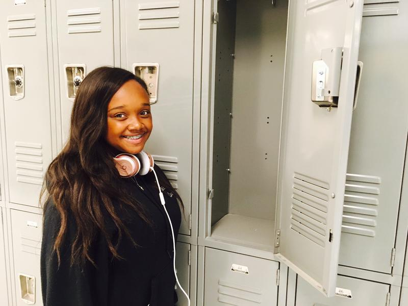 a high school sopohmore at a locker