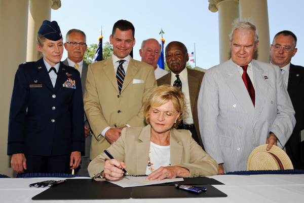North Carolina Governor Bev Perdue signs House Bill 799 at the Wayne County Veterans Memorial in downtown Goldsboro, N.C. July 24, 2012.