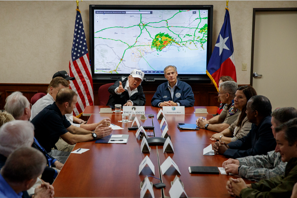 Trump sits at head of table to discuss public safety operations in Texas in the aftermath of hurricane Harvey.