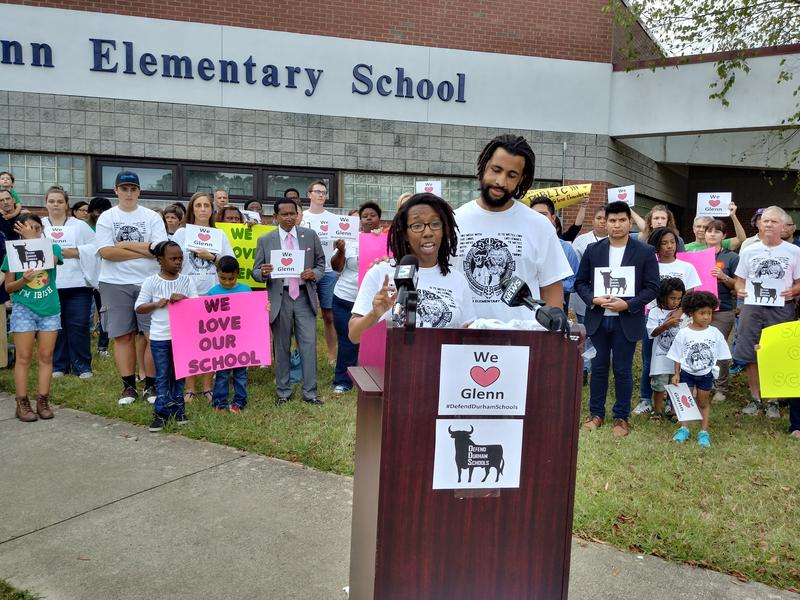 Glenn Elementary parents Tamara and David Vanie address the crowd at a parent rally against the Innovative School District, which could bring a state takeover to their East Durham school.
