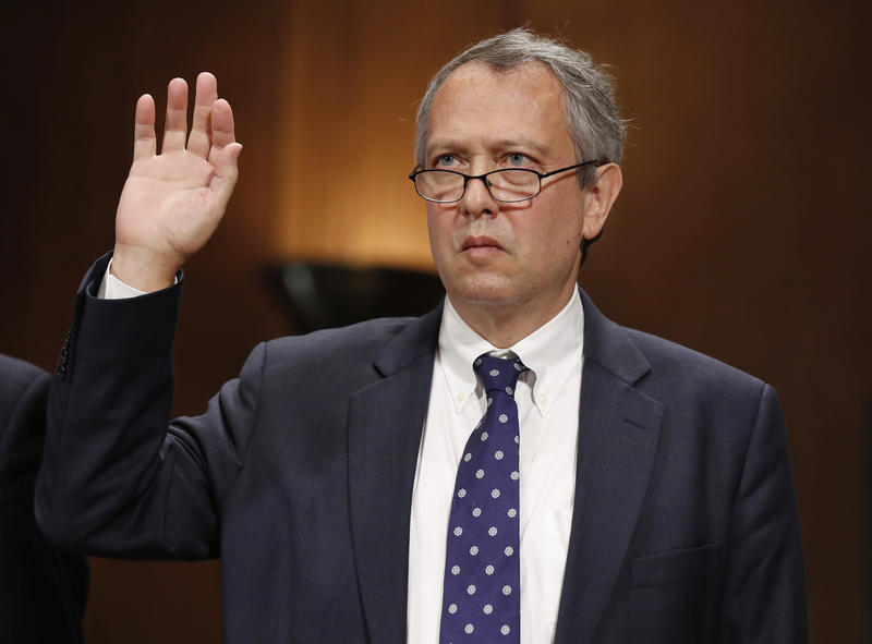 Thomas Farr, with right hand raised, is sworn in during a Senate Judiciary Committee.