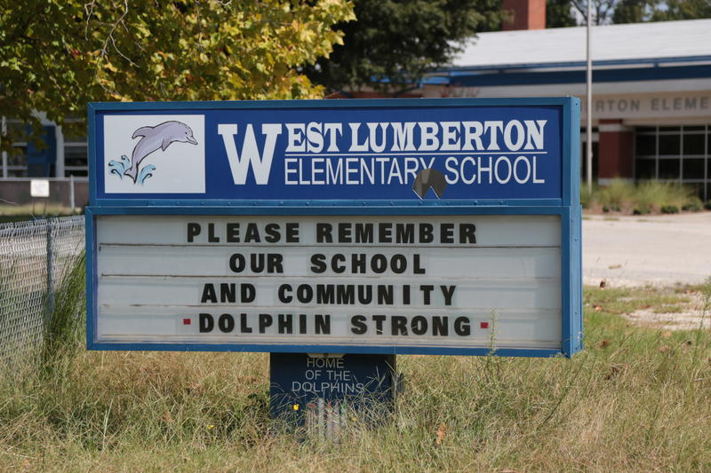 A sign in front of West Lumberton Elementary, the only Robeson County school that remains closed a year after Hurricane Matthew. The storm dumped about three feet of standing water into the building, and destroyed many of its students' homes.