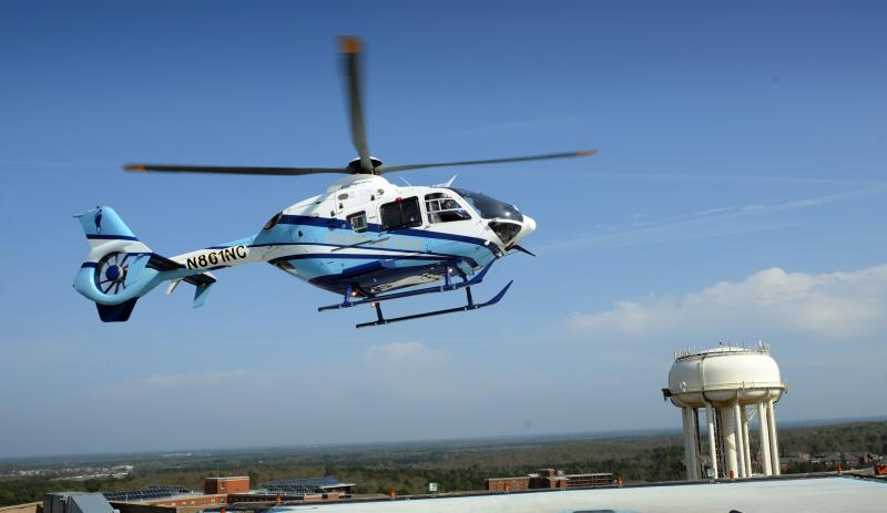 An air ambulance lands on the helipad at UNC Hospitals at the University of North Carolina at Chapel Hill